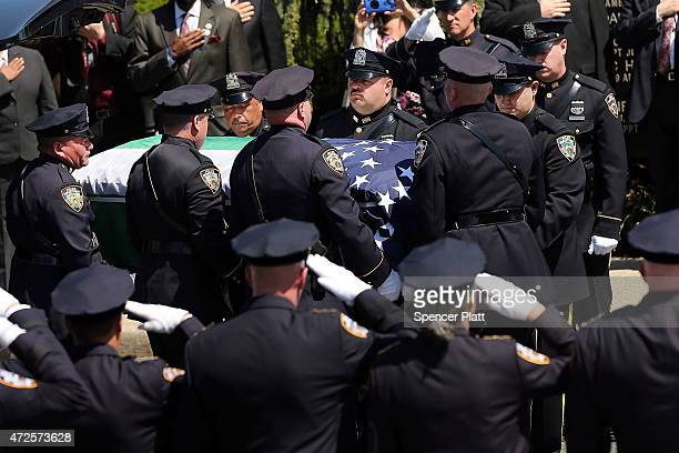 The casket for fallen New York City police officer Brian Moore is brought into a Long Island church on May 8 2015 in Seaford New York Officer Moore...