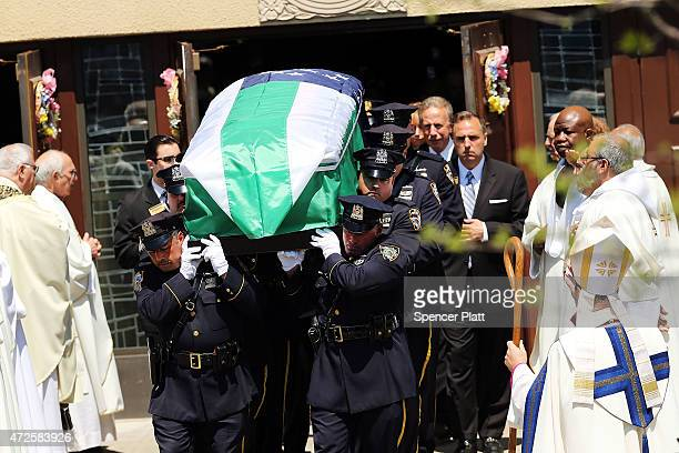 The casket for fallen New York City police officer Brian Moore is brought out of a Long Island church on May 8 2015 in Seaford New York Officer Moore...