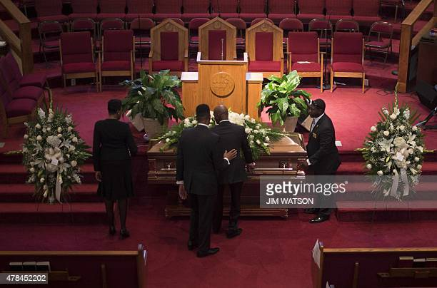 The casket holding Emanuel AME Church shooting victim Ethel Lance is moved into position ahead of her funeral at the Royal Missionary Baptist Church...
