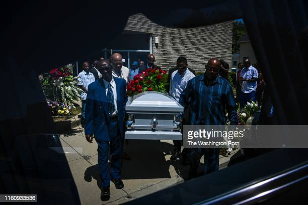 The casket holding the body of Derrick Fudge is carried from the church at the end of the funeral of Derrick Fudge who was one of nine people killed...