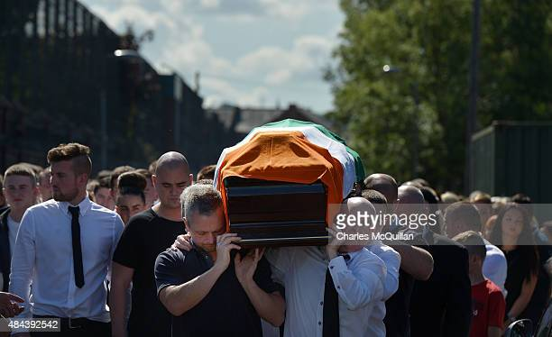 The casket is carried as the funeral takes place of former IRA member Kevin McGuigan Sr on August 18, 2015 in Belfast, Northern Ireland. The father...
