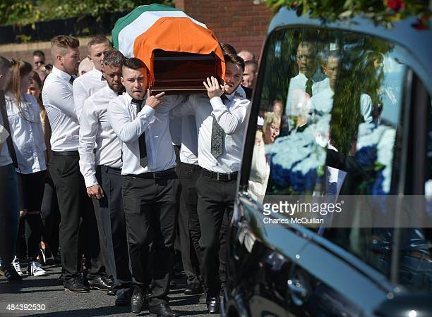 The casket is carried in as the funeral takes place of former IRA member Kevin McGuigan Sr on August 18, 2015 in Belfast, Northern Ireland. The...