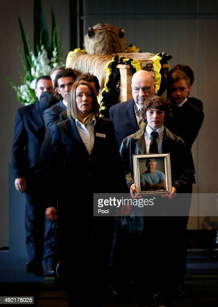 The casket is carried out by his grandsons after the Tom Hafey funeral service at Melbourne Cricket Ground on May 19 2014 in Melbourne Australia...