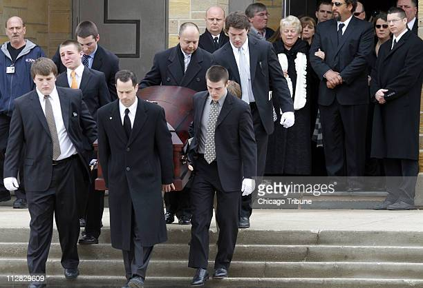 The casket is carried out of St. Rita of Cascia Shrine Chapel in Chicago, Illinois, Monday, March 1, 2010 after the funeral of SeaWorld's Dawn...