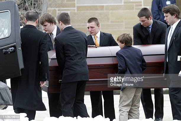 The casket is carried out of St Rita of Cascia Shrine Chapel in Chicago Illinois Monday March 1 2010 after the funeral of SeaWorld's Dawn Therese...