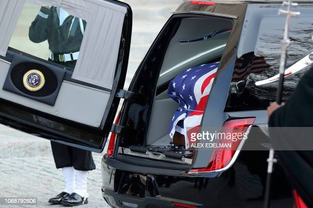 The casket is loaded for transfer outside the National Cathedral at the close of the state funeral for former US President George HW Bush December 5...