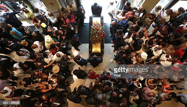 The casket is removed from the church following the funeral services of Michael Brown inside Friendly Temple Missionary Baptist Church on August 25...