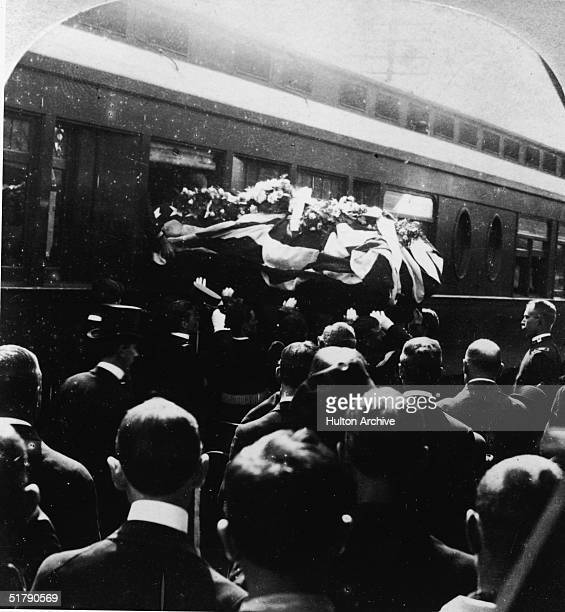 The casket of American politician William McKinley , the 25th President of the United States, is removed from a train car during funeral services in...