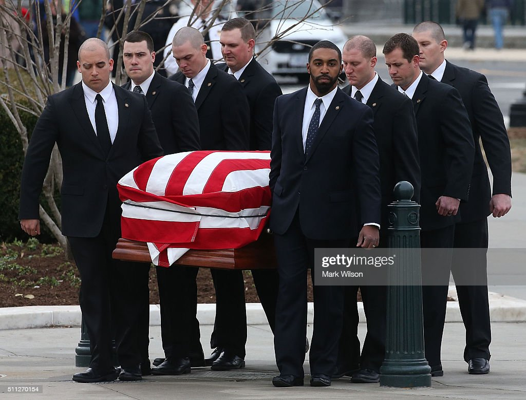 The casket of Associate Justice Antonin Scalia is carried by US Supreme Court police officers, at the Supreme Court building, February 19, 2016 in Washington, DC. Justice Scalia will lie in repose in the Great Hall, where visitors can pay their respects.