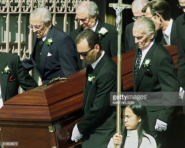 The casket of baseball great Joe DiMaggio is carried down the steps of Saint's Peter and Paul Parish by friends and family members including his son...