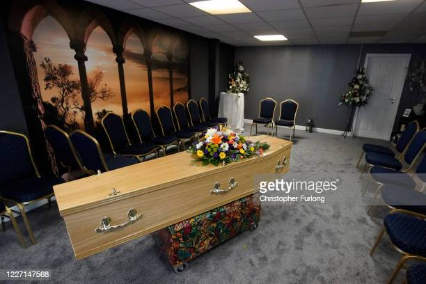 The casket of Covid-19 victim Dennis Clapham, aged 62, is prepared to be transported to Nab Wood Crematorium on May 26, 2020 in Shipley, West...