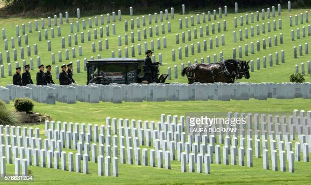 TOPSHOT The casket of Dallas Police officer Patricio Zamarripa arrives for burial in the Dallas Fort Worth National Cemetery on July 16 in Dallas...