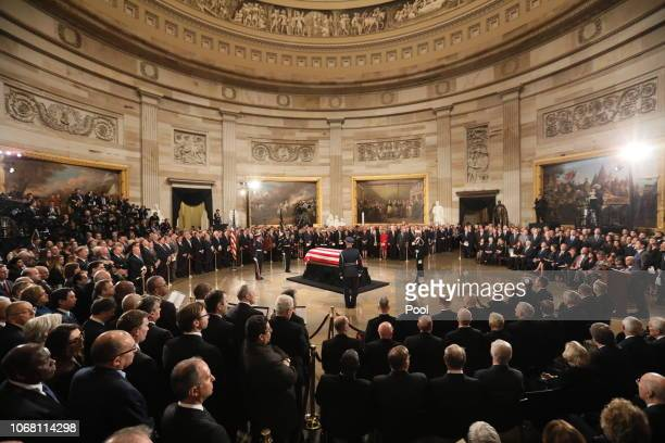 The casket of former President George HW Bush lies in state in the US Capitol Rotunda on December 3 2018 in Washington DC A WWII combat veteran Bush...