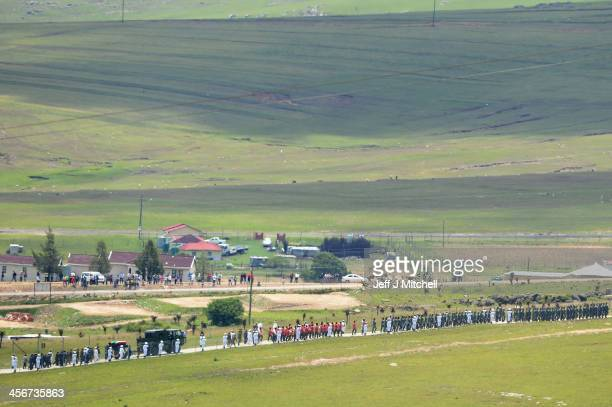 The casket of former South African President Nelson Mandela is taken to the burial site where he is to be buried on his family's property in his...