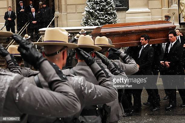 The casket of former threeterm governor Mario Cuomo departs St Ignatius Loyola Church on January 6 2015 in New York City Mario Cuomo who was once...