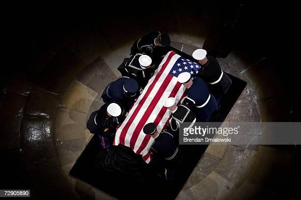 The casket of former U.S. President Gerald Ford arrives during funeral services for former U.S. President Gerald Ford in the Rotunda of the U.S....