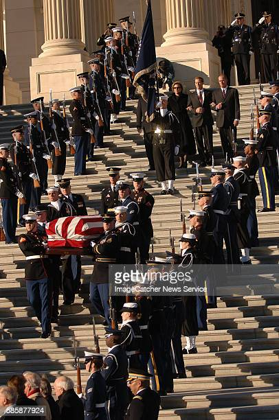 The casket of former US president Gerald R Ford is carried by military pallbearers out of the US Capitol building rotunda after lying instate for...