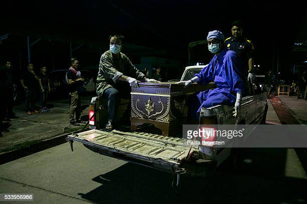 The casket of Kanjanaporn Lasasong age 8 arrives after DNA tests were completed in Wiang Papao Chiang Rai province May 24 2016 A tragic fire broke...