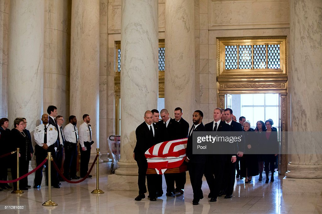 The casket of late Supreme Court Justice Antonin Scalia is carried into the Great Hall of the Supreme Court for a private ceremony on February 19, 2016 in Washington, DC. Justice Scalia will lie in repose in the Great Hall of the high court where visitors will pay their respects.