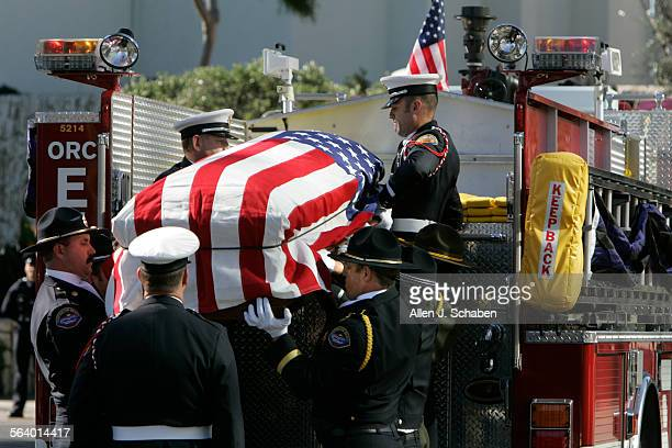 The casket of Msgr. John Sammon, Orange County's oldest priest and a former fire and police chaplain for more than 60 years, arrives at the Crystal...