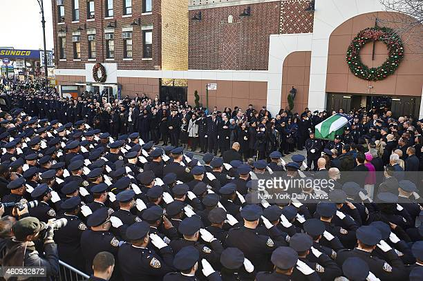 The casket of New York Police Department officer Rafael Ramos is brought out of Christ Tabernacle Church during his funeral Officer Ramos and his...