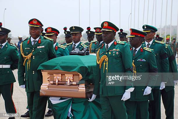 The casket of Nigeria's secessionist leader Odumegwu Ojukwu is carried after arrival at the Presidential Wing of Inamdi Azikiwe International Airport...