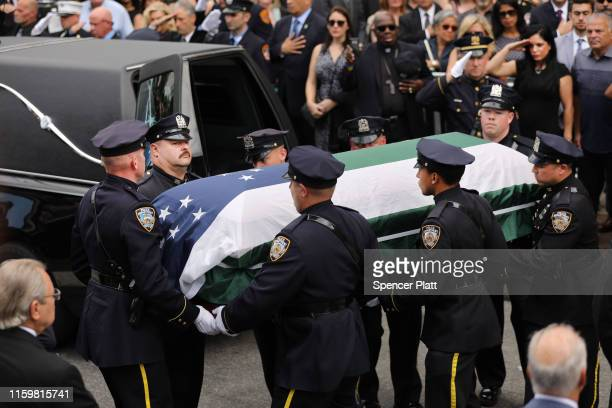 The casket of retired NYPD detective Luis Alvarez is brought into Immaculate Conception Church on July 03 2019 in the Queens borough of New York City...