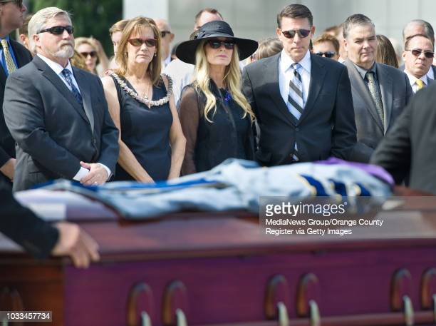 The casket of Rev Robert H Schuller is adorned with his robe during services at Christ Cathedral in Garden Grove Monday From left his soninlaw and...