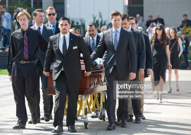 The casket of Reverend Robert H. Schuller is accompanied by family members at Christ Cathedral in Garden Grove for funeral services Monday. ....