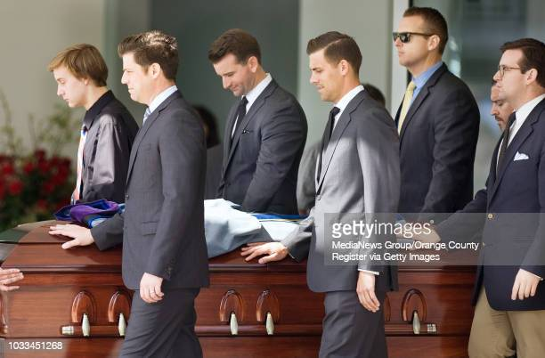 The casket of Reverend Robert H. Schuller is accompanied by family members, including grandson Bobby Schuller, front left, at Christ Cathedral in...