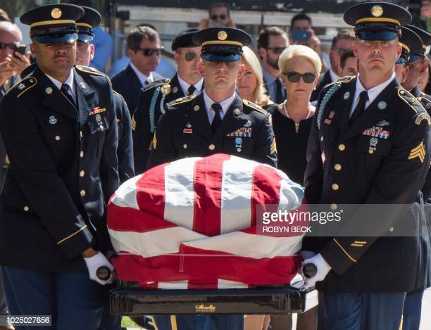 The casket of Senator John McCain is carried by members of the Arizona National Guard toward the Arizona State Capitol Rotunda followed by wife Cindy...