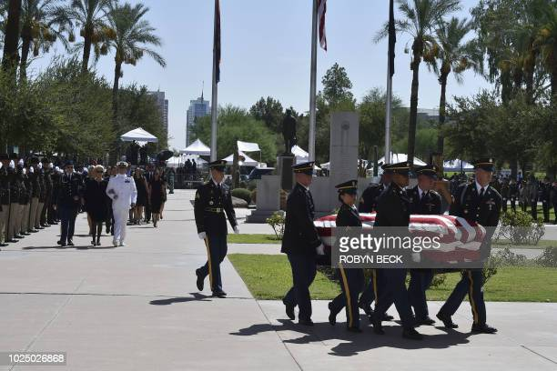 The casket of Senator John McCain is carried by members of the Arizona National Guard to the Arizona State Capitol Rotunda where he will lie in...
