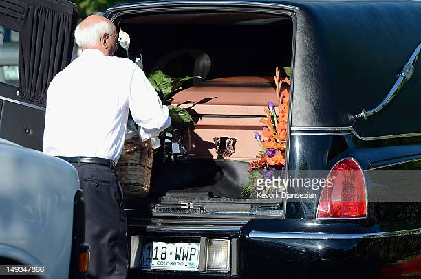 The casket of shooting victim Alexander Jonathan 'AJ' Boik who recently graduated from Gateway High School is taken out of the hearse at Queen of...