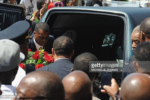 The casket of slain 18yearold Michael Brown Jr is loaded into a hearse following funeral services at Friendly Temple Missionary Baptist Church in St...