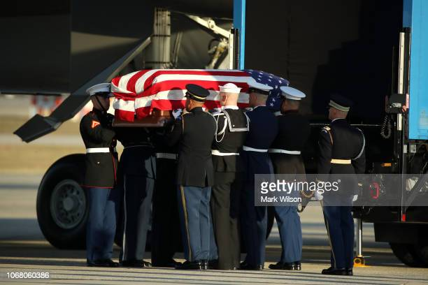 The casket of the remains of former US President George HW Bush is carried out of the US Air Force 747 being called 'Special Mission 41' on its way...