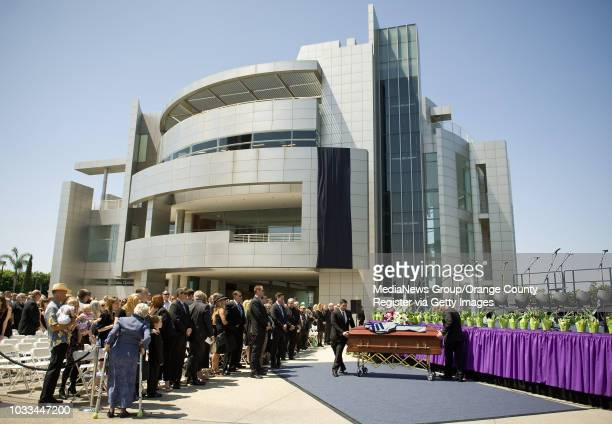 The casket of the Rev. Robert H. Schuller is carried to the Memorial Gardens at Christ Cathedral in Garden Grove after a public service on Monday. He...