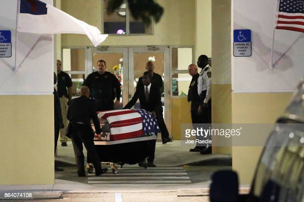 The casket of US Army Sgt La David Johnson is wheeled to the hearse after the viewing at the Christ the Rock Community Church on October 20 2017 in...