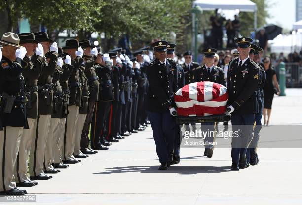 The casket of US Sen John McCain is carried into the Arizona State Capitol on August 29 2018 in Phoenix Arizona US Sen John McCain will lie in State...