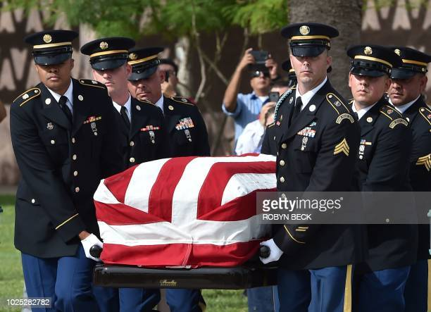 The casket of US Senator John McCain leaves the Arizona State Capitol on August 30 2018 in Phoenix Arizona A motorcade will bring the casket to North...