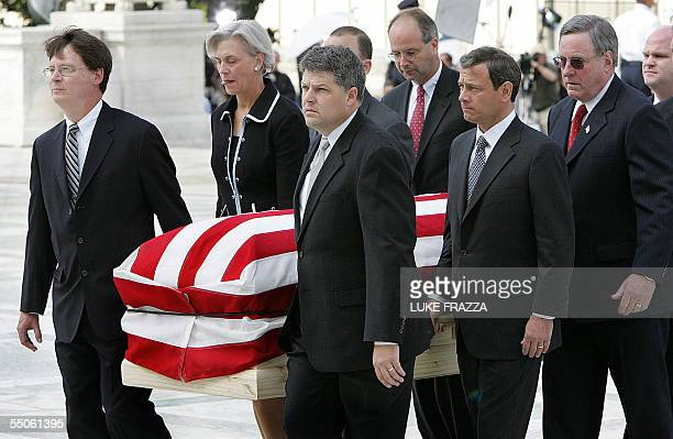 The casket of US Supreme Court Chief Justice William Rehnquist is carried by his former Court clerks up the stairs of the Supreme Court in...