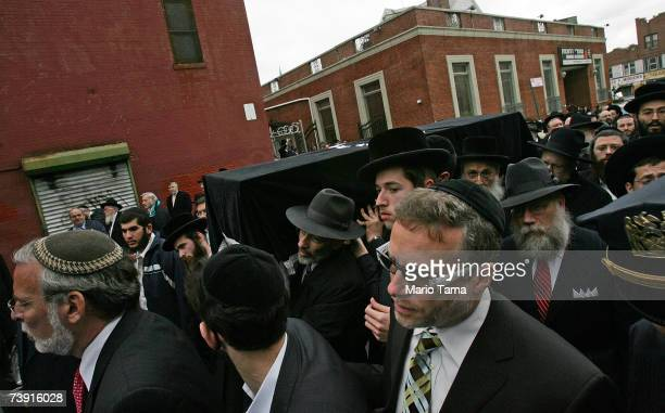 The casket of Virginia Tech lecturer and shooting victim Liviu Librescu is carried down a Brooklyn street after his funeral April 18 2007 in the...