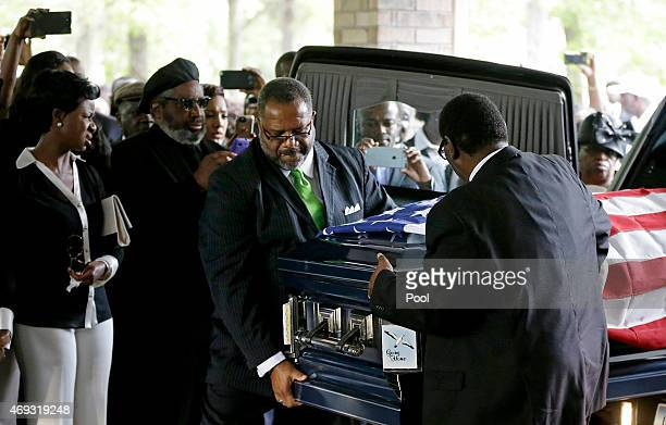The casket of Walter Scott is removed from a hearse for his funeral at WORD Ministries Christian Center April 11 2015 in Summerville South Carolina...