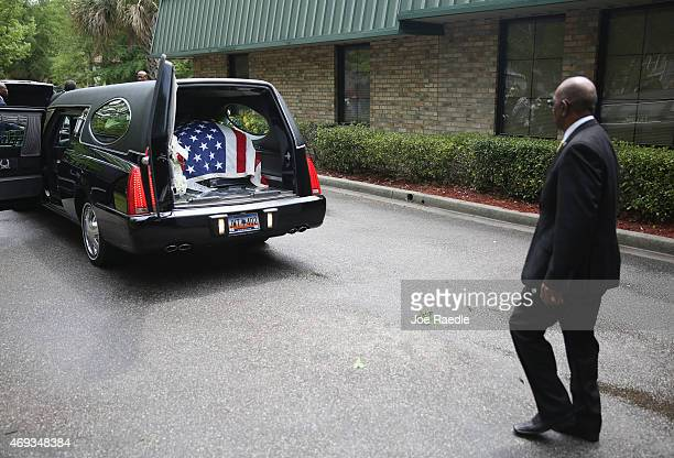 The casket of Walter Scott sits in the hearse after a funeral service at the WORD Ministries Christian Center after he was fatally shot by a North...