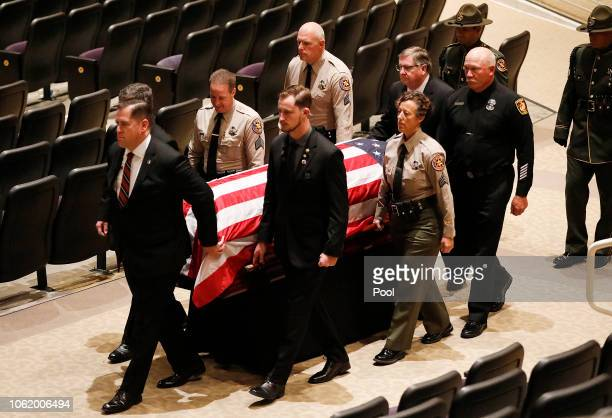 The casket with the body of Ventura County Sheriff Sgt Ron Helus is carried out after a memorial service for Sgt Helus at Calvary Community Church on...