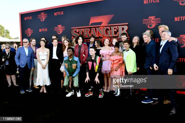 The cast and crew including Joe Keery Winona Ryder David Harbour Dacre Montgomery Sadie Sink Millie Bobby Brown Gaten Matarazzo Caleb McLaughlin Finn...