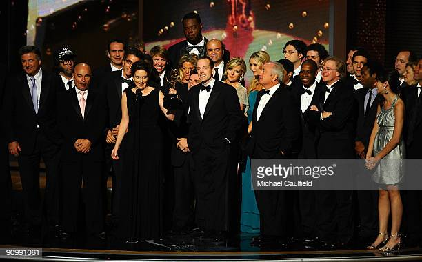 The cast and crew of '30 Rock' accept their award onstage at the 61st Primetime Emmy Awards held at the Nokia Theatre on September 20 2009 in Los...