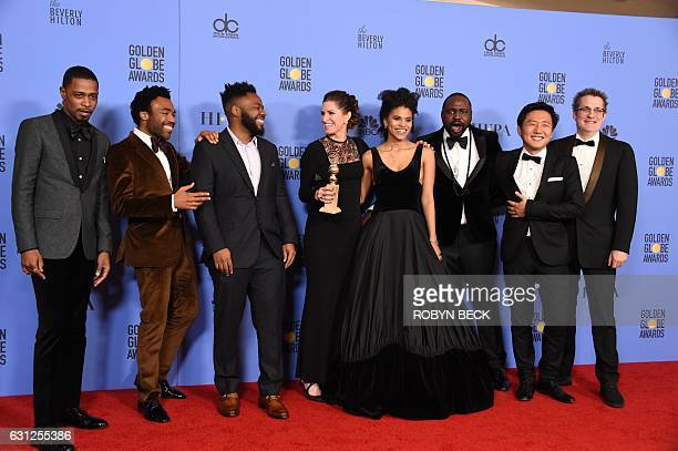 The cast and crew of Atlanta pose with the Best TV Series Comedy or Musical award in the press room at the 74th annual Golden Globe Awards, January 8...