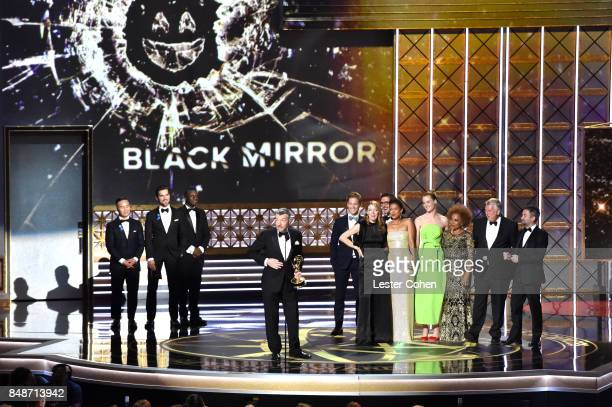 The cast and crew of Black Mirror accept an award onstage during the 69th Annual Primetime Emmy Awards at Microsoft Theater on September 17 2017 in...
