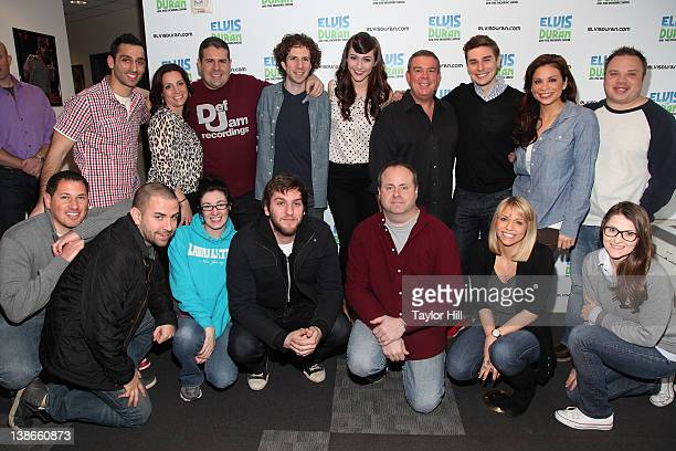 The cast and crew of Elvis Duran and the Morning Show pose with Karmin before their Saturday Night Live performance at Z100 Studios on February 10...