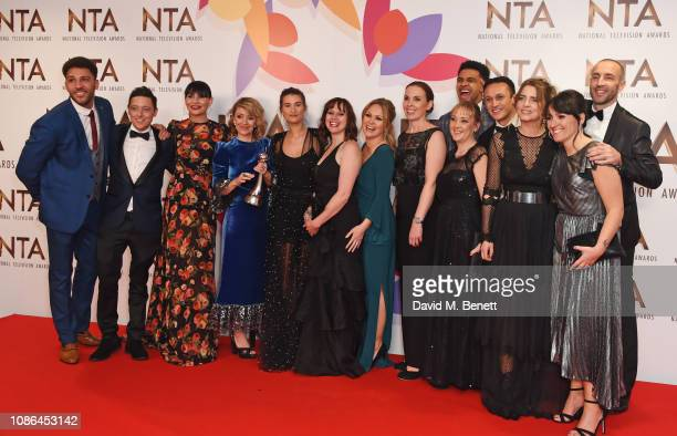 The cast and crew of Emmerdale winner of the Best Serial Drama award pose in the Winners Room during the National Television Awards held at The O2...